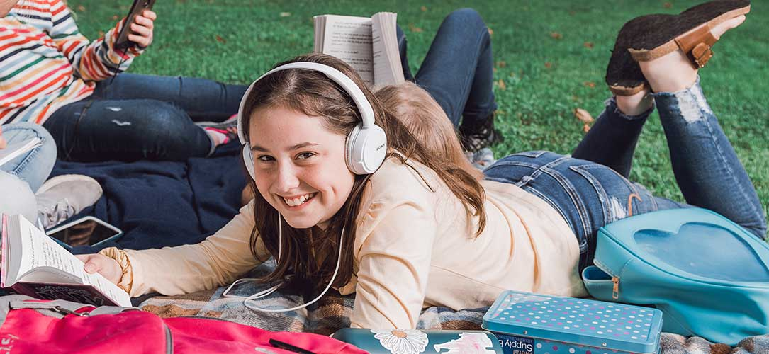 Girl in headphones smiling